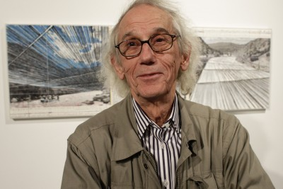 FILE - This Wednesday, Jan. 23, 2013 file photo shows artist Christo  during a show of sketches and photos of some of his in-progress works at the Metropolitan State University Center for Visual Art in Denver. Christo and his late wife, Jeanne-Claude, have won state and federal permits to build Over the River, which would involve suspending nearly six miles of giant fabric panels from anchors and cables over parts of a 42-mile stretch of the Arkansas River next to U.S. 50. Yet construction is on hold, as of August 2013 due to lawsuits challenging the approvals the project received. (AP Photo/Brennan Linsley)